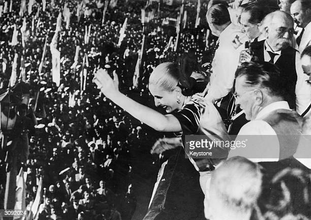 Eva Peron the second wife of Argentinian president Juan Peron greeting the crowds from the balcony of Government House Buenos Aires on the fifth...