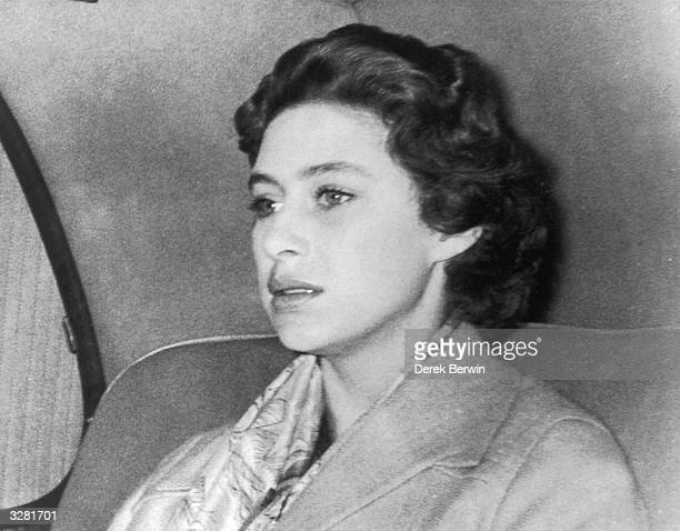 A troubled Princess Margaret returns to Clarence House after a weekend in the country where Group Captain Peter Townsend was also a guest The...