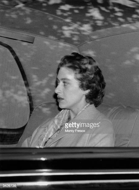 Princess Margaret Rose returns to Clarence House London after a weekend in the country where Group Captain Peter Townsend was also a guest The...