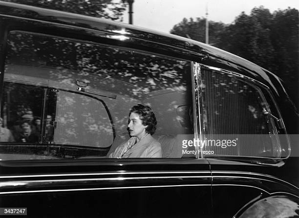 Princess Margaret Rose younger daughter of King George VI and Queen Elizabeth and sister of Queen Elizabeth II in a limousine on her way to Clarence...