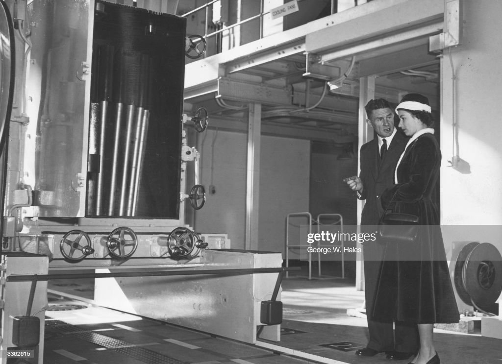 Queen <a gi-track='captionPersonalityLinkClicked' href=/galleries/search?phrase=Elizabeth+II&family=editorial&specificpeople=67226 ng-click='$event.stopPropagation()'>Elizabeth II</a> inspecting a Charge Fuel Basket of Uranium rods during the opening ceremony of Calder Hall Atomic Energy Power Station, Cumbria.