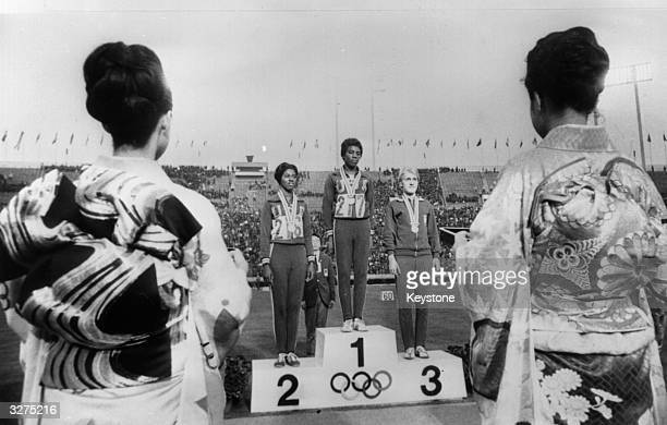 Left to right on the winners podium at the Olympic Games in Tokyo Edith McGuire Wyomia Tyus American winner of the Women's 100m and Ewa Klobukowska...