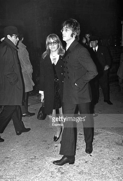 British pop musician and singer songwriter John Lennon and his wife Cynthia arriving at the memorial service of Beatles manager Brian Epstein
