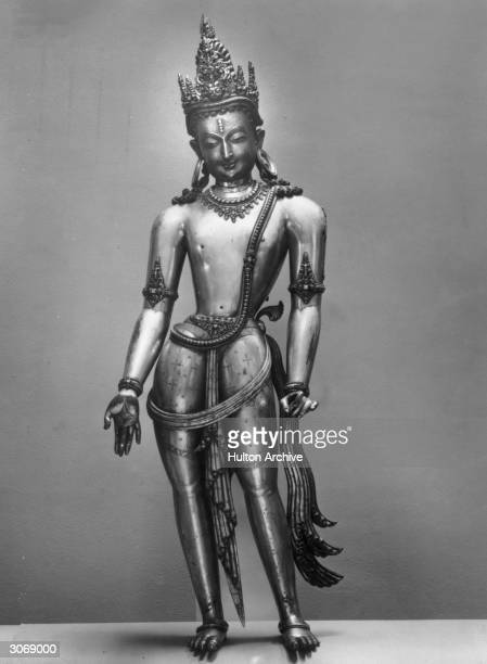 The figure of Avalokitesvara in copper at an Indian sculpture exhibition at the Victoria and Albert Museum in London