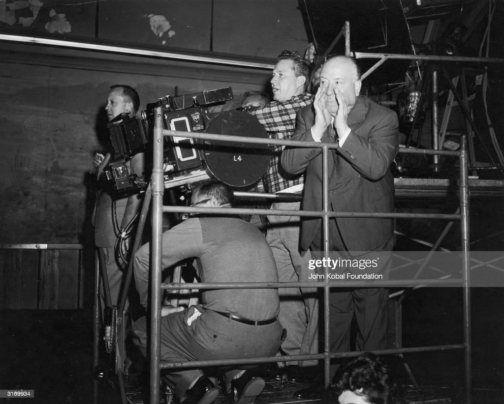 British director Alfred Hitchcock (1899 - 1980) shouting instructions during the filming of a scene for 'North by Northwest' at LaSalle Street Station, Chicago.