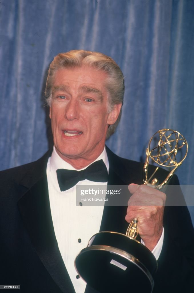 Headshot of American actor Richard Mulligan (1932 - 2000) holding his Emmy on stage at the Emmy Awards, Los Angeles, California. He won the award for his starring role in the television comedy series, 'Empty Nest.'