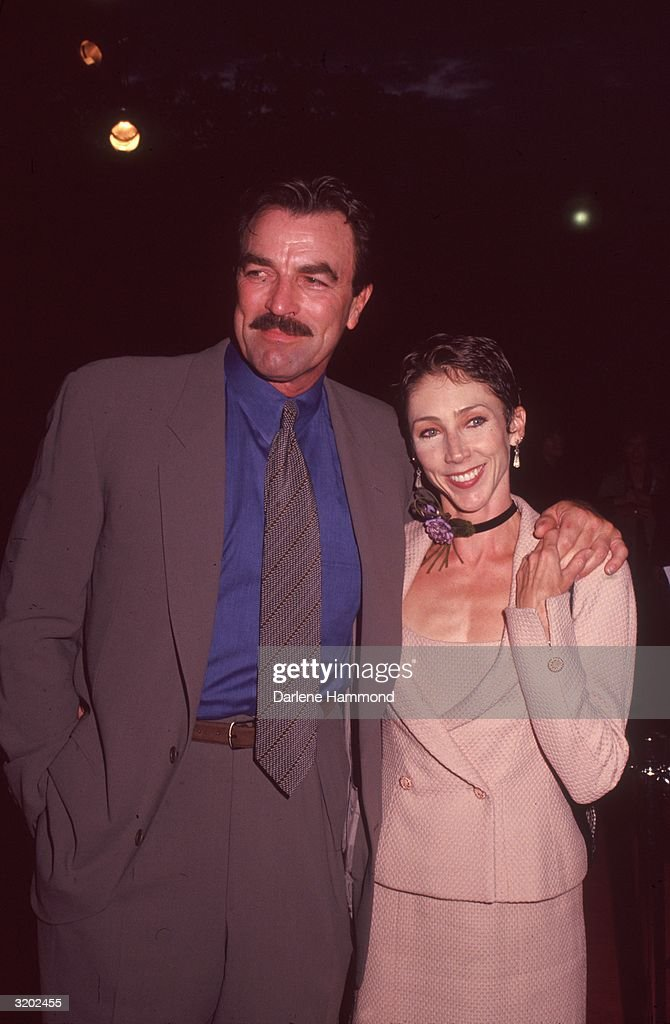 American actor <a gi-track='captionPersonalityLinkClicked' href=/galleries/search?phrase=Tom+Selleck&family=editorial&specificpeople=208627 ng-click='$event.stopPropagation()'>Tom Selleck</a> and his wife, <a gi-track='captionPersonalityLinkClicked' href=/galleries/search?phrase=Jillie+Mack&family=editorial&specificpeople=642455 ng-click='$event.stopPropagation()'>Jillie Mack</a>, attend the premiere of director Frank Oz's film, 'In & Out,' in which Selleck starred, Hollywood, California. The proceeds of the premiere benefited the National Gay and Lesbian Task Force Policy Institute.