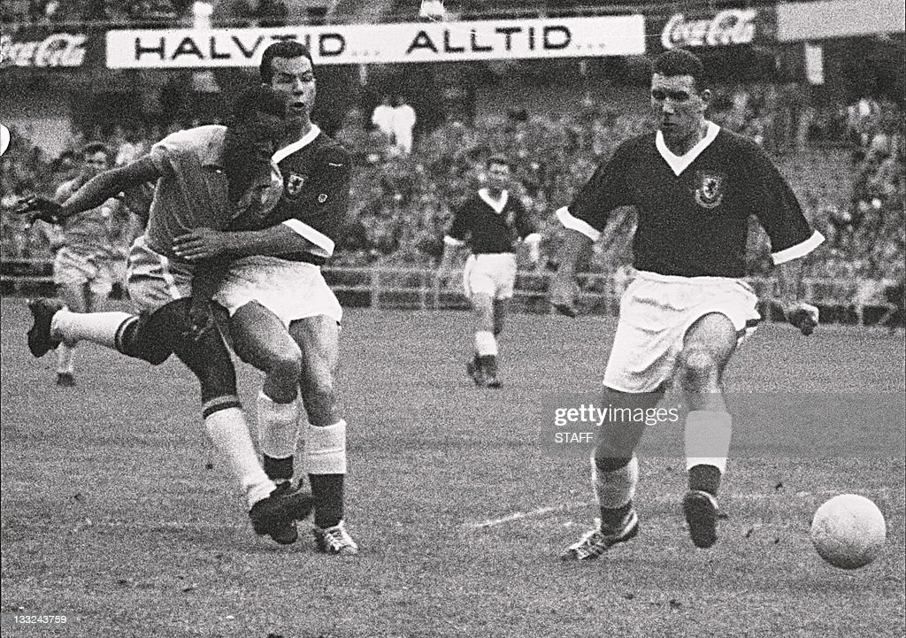 17yearold Brazilian forward Pele kicks the ball past two Welsh defenders during the World Cup quarterfinal soccer match between Brazil and Wales 19...