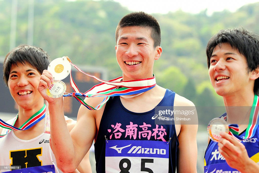 17-year-old high school student Yoshihide Kiryu (C) poses for photographs after winning the Men's 100m final during the Mikio Oda Memorial Athletics Championships at Edion Stadium Hiroshima on April 29, 2013 in Hiroshima, Japan.