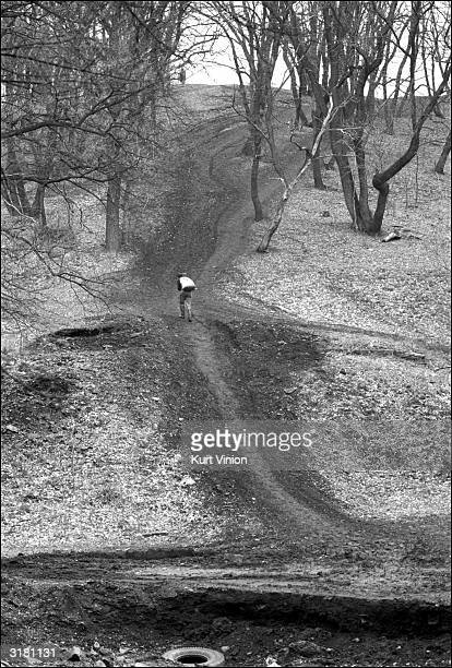 A 17yearold makes the difficult uphill journey with a 100pound bag of coal on his back February 2002 near Snezhnoye Ukraine Though used to the...