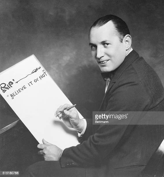 1/8/1932Robert L Ripley cartoonist and creator of 'Believe it or Not' is shown drawing on a board that says 'Rip Believe it or Not'