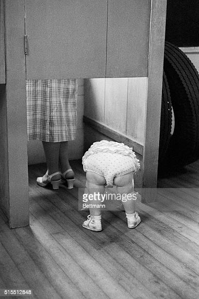 18monthold Susan Bryant does all but follow her mother into the voting booth to make sure her favorite gets Ma's vote The tiny constituent a resident...