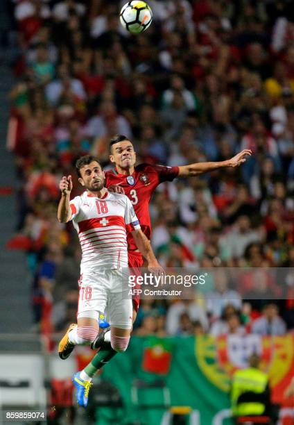 18Swiss forward Admir Mehmedi and Portugals defender Pepe jump for the ball during the FIFA World Cup 2018 Group B qualifier football match between...