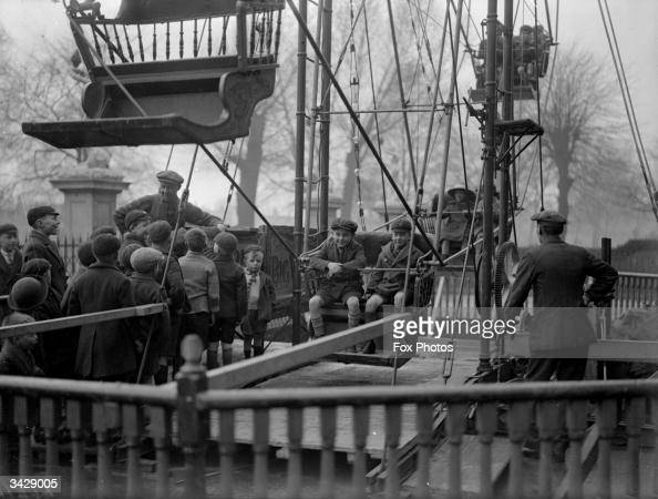 Schoolchildren queue up for a ride at the fair at Peckham Rye London