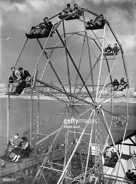 Holidaymakers enjoying the views from the new giant wheel on the end of Palace Pier Brighton England