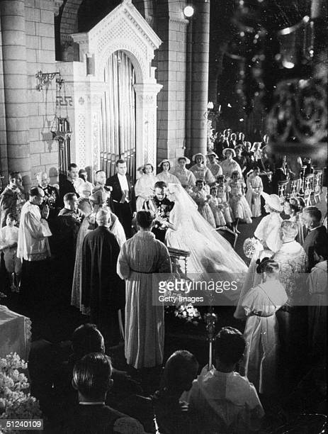 Prince Rainier III and American actress Grace Kelly at the altar of Monaco Cathedral during their wedding