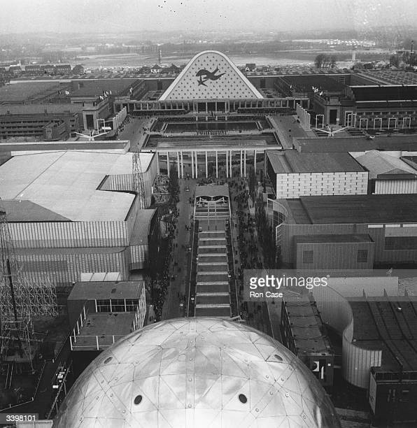 A plaza at the Brussels Fair viewed from the top of the atomium a structure made of nine joined spheres to represent a magnified iron crystal with...