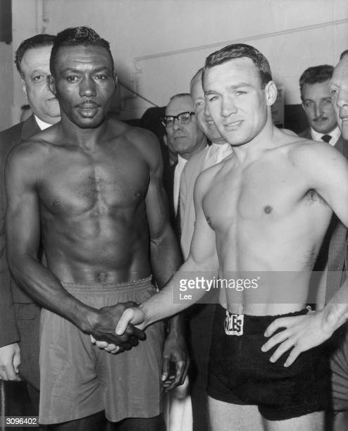 British European and Empire lightweight champion Dave Charnley meets world champion Joe Brown for a weighin before their title fight at Earl's Court...