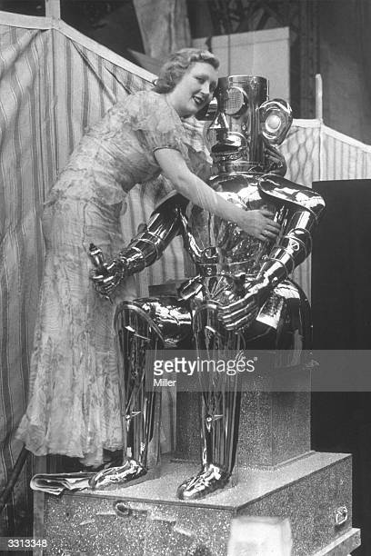 Film star Muriel Angelina hugging a robot at the Olympia Radio Exhibition London The robot is named Alpha and was invented by Harry May for the...