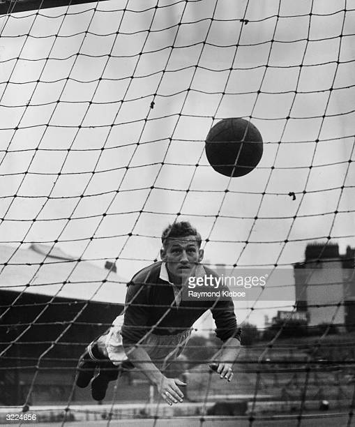 Chelsea player Roy Bentley dives for the ball during a practice session at Stamford Bridge Original Publication Picture Post 5378 Football Is Big...