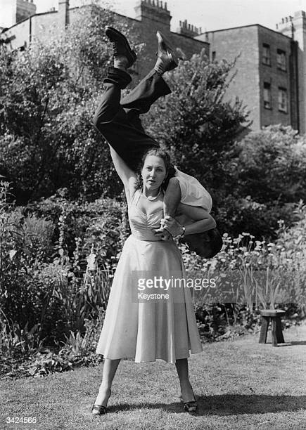 Stuntwoman Connie Tilton tough girl of British films swings a man round on her shoulders