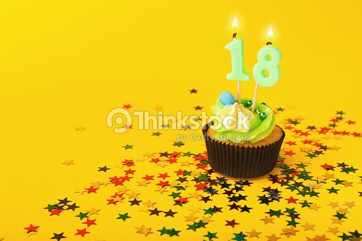 18th Birthday Cupcake With Candle And Sprinkles Stock Photo