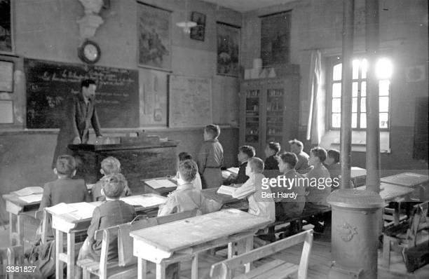 A teacher addresses the schoolchildren in the French village of MontpresChambord Original Publication Picture Post 4704 A Village In France pub 1948