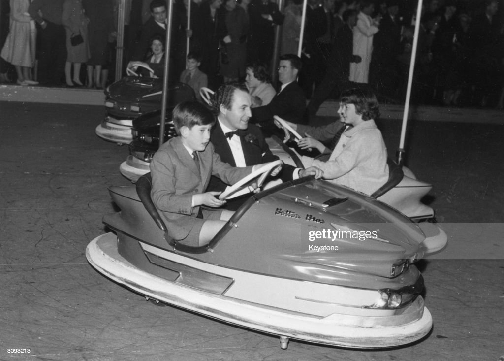 Prince Charles at the wheel of a dodgem car at Bertram Mills Circus and Funfair at Olympia, London.