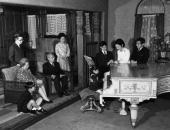 A New Year photograph showing the Japanese Imperial Family at the Imperial Palace Tokyo They are watching the youngest member of the family play the...