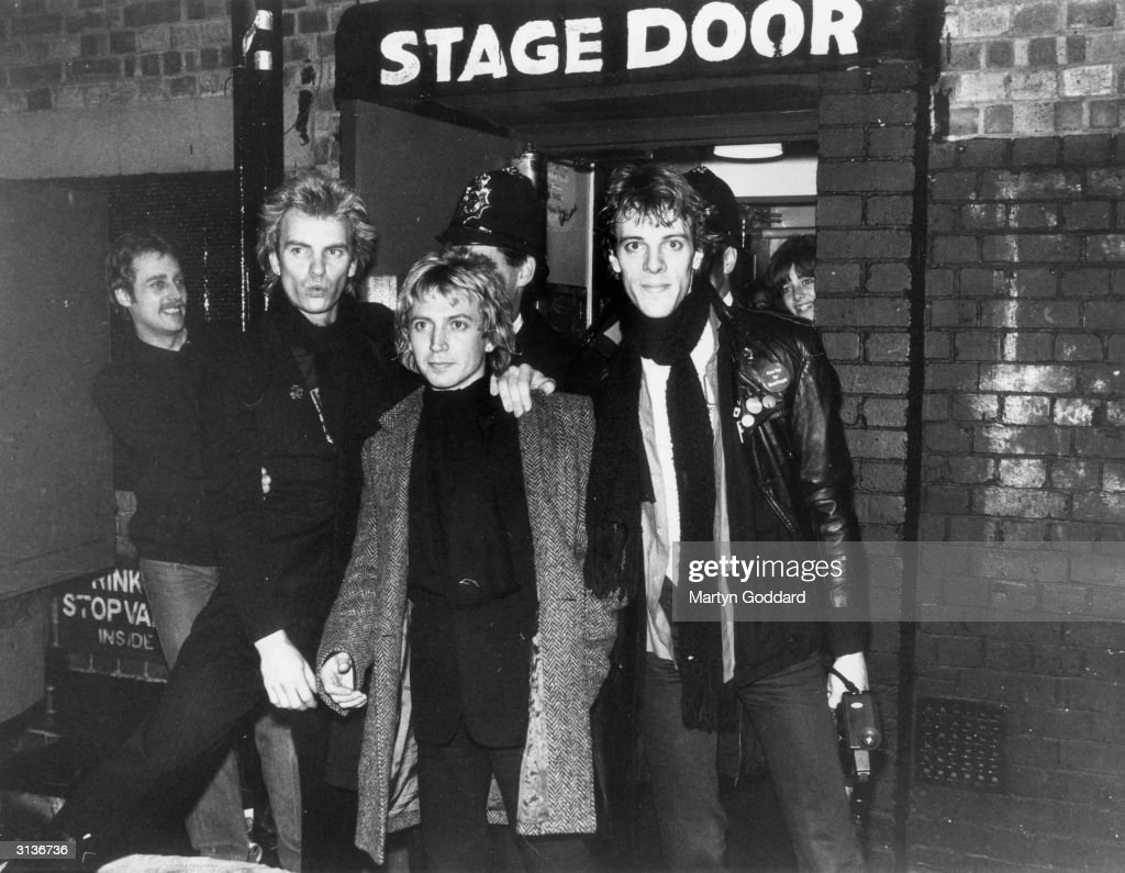 The pop group Police outside the stage door of a Hammersmith venue in west London, with a policeman standing behind them. From left to right, they are <a gi-track='captionPersonalityLinkClicked' href=/galleries/search?phrase=Sting+-+Singer&family=editorial&specificpeople=220192 ng-click='$event.stopPropagation()'>Sting</a>, <a gi-track='captionPersonalityLinkClicked' href=/galleries/search?phrase=Andy+Summers&family=editorial&specificpeople=789834 ng-click='$event.stopPropagation()'>Andy Summers</a> and <a gi-track='captionPersonalityLinkClicked' href=/galleries/search?phrase=Stewart+Copeland&family=editorial&specificpeople=228804 ng-click='$event.stopPropagation()'>Stewart Copeland</a>.