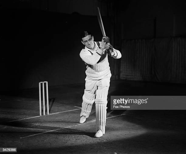 Walter 'Wally' Hammond captain of the England and Worcestershire cricket team gives a demonstration of batting technique
