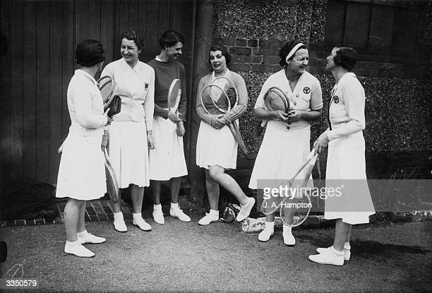 Members of the Surrey team including Mary Whitmarsh and Betty Nuthall chatting before play in the Women's InterCounty Lawn Tennis Tournament at the...