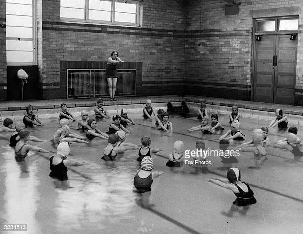 Girls at Woodthorpe Council School an elementary school run by Sheffield Education Committee learning how to swim in their newlycompleted swimming...
