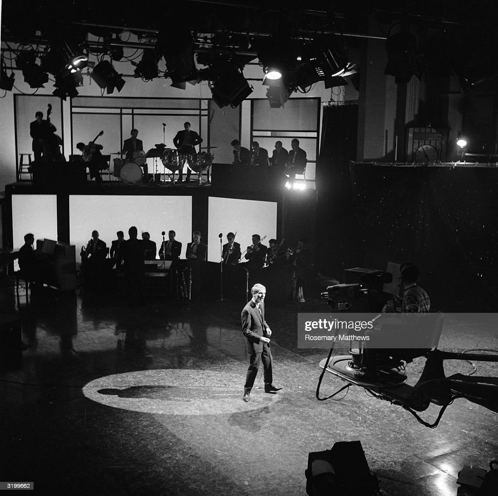 English pop star Adam Faith (1940 - 2003) makes an recording at the BBC television studio in Shepherd's Bush, London, for the programme 'The Musical Fifties'.