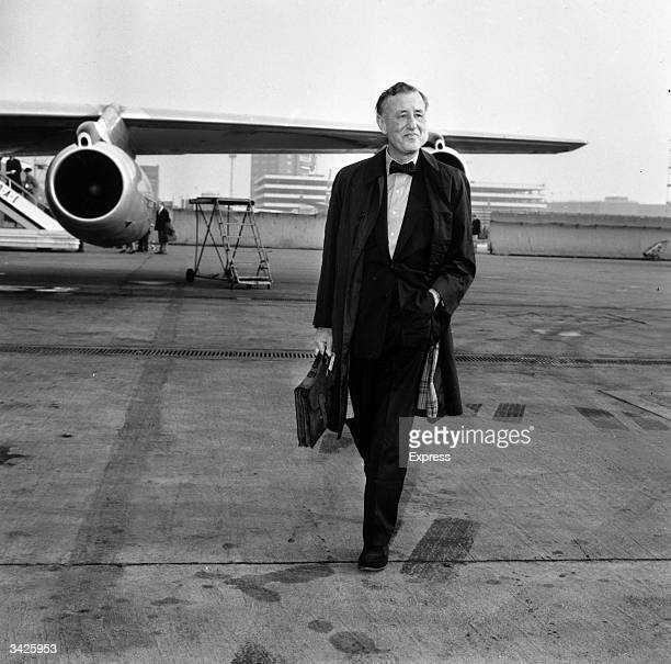 Ian Fleming author of the James Bond novels at an airfield