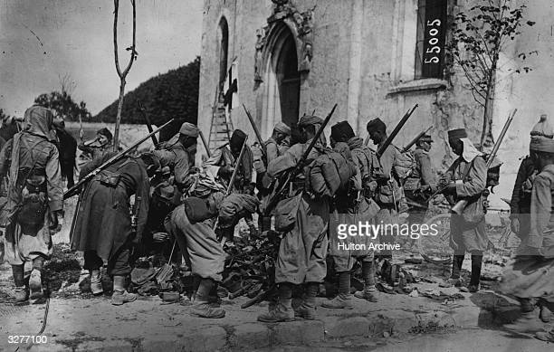 The Algerian Infantry collect weapons captured from the Germans after The Battle of the Marne