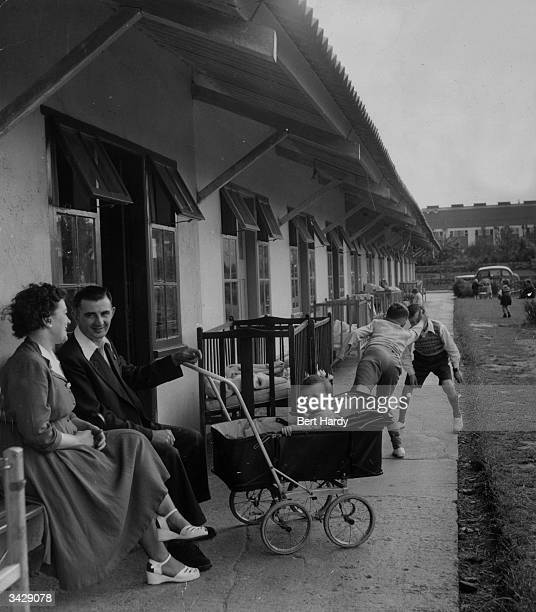 A family sitting outside their chalet at the Butlin's holiday camp in Filey Original Publication Picture Post 6589 Picture Post Visits A Holiday Camp...