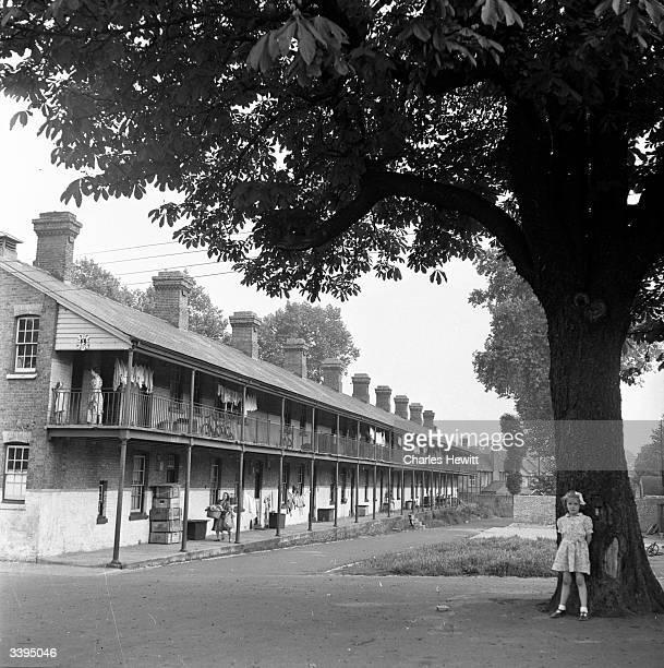 Dilapidated married quarters at Combermere Barracks at Windsor in Berkshire Original Publication Picture Post 6592 Scandal At Windsor pub 1953