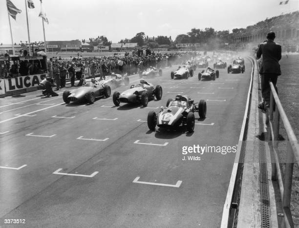 Racing cars accelerating at the start of a 225 mile Grand Prix at Aintree Liverpool