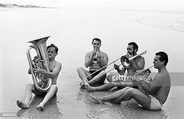 Four musicians from the London Symphony Orchestra play their instruments on Daytona Beach Florida They are George Reynolds Alan Jenkins David Gray...
