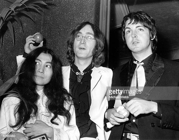 Beatle John Lennon and his Japanese girlfriend Yoko Ono with Beatle Paul McCartney right at the premiere of the new Beatles film 'Yellow Submarine'...