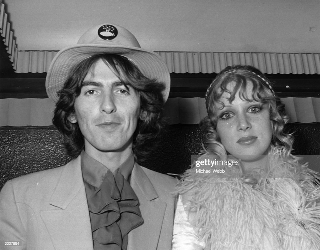 George Harrison (1943 - 2001) of The Beatles and his wife Patti Boyd arriving at the London Pavilion for the world premiere of the new Beatles film 'Yellow Submarine'.