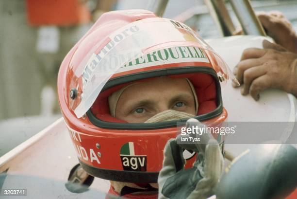 Austrian racing driver Niki Lauda gestures he is pleased with his car before the British Grand Prix at Brands Hatch