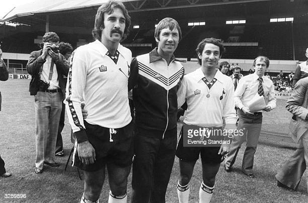 Tottenham Hotspur manager Keith Burkinshaw shows off his new Argentinian World Cup star signings Osvaldo Ardiles and Ricardo Villa to the press at...