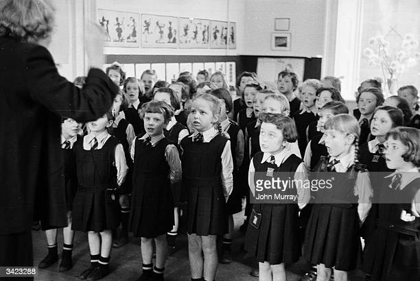 A classroom of young pupils at the Glasgow High School for Girls all singing in unison Garnethill Public School became the Glasgow High School for...