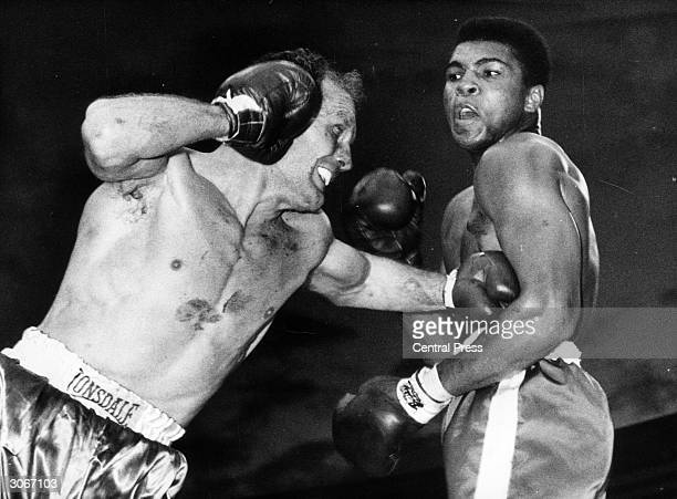 American heavyweight boxer Cassius Clay fighting Henry Cooper at Wembley