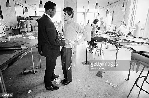 Fashion designer Ossie Clark has his waist measured during his term as a student at the Royal School of Art and Fashion