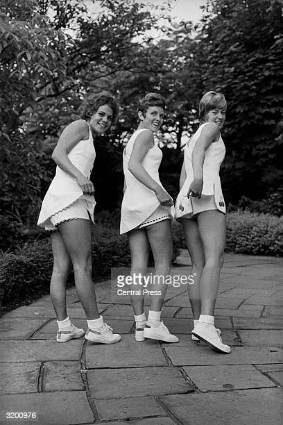 Tennis stars Evonne Goolagong wearing a 'Dacron' polyester buttonthrough dresswith slit scalloped skirt trimmed with lilac and teamed with matching...