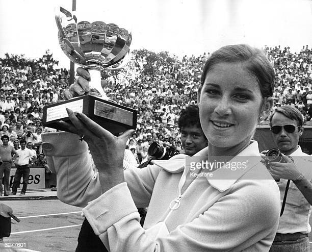 American tennis player Chris Evert holding the trophy after winning the women's title at the French Open in Paris