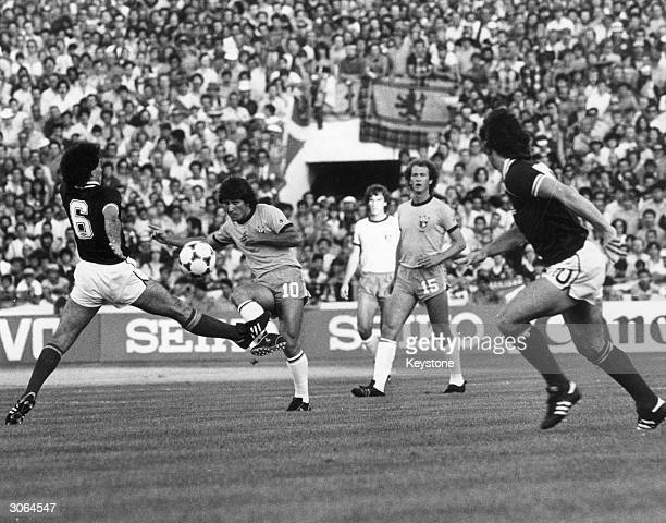 Players in action during the Brazil versus Scotland match in Seville Spain during the 1982 world cup Willie Miller Zico Jose Oscar Bernadi Falcao and...